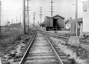View of rail yard, tracks and buildings in Cloverdale, around 1910
